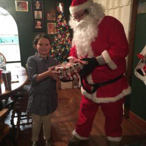 Santa Delivers presents to Elk City Kids